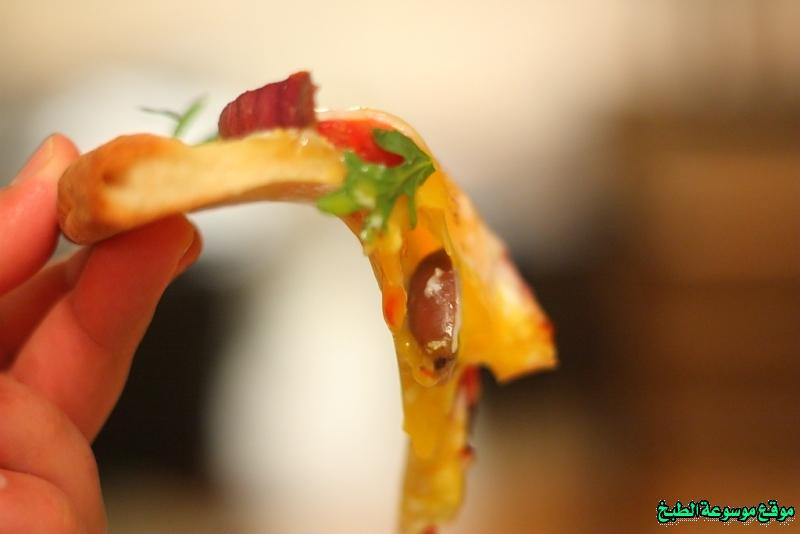 http://photos.encyclopediacooking.com/image/recipes_pictures%D8%B7%D8%B1%D9%8A%D9%82%D8%A9-%D8%B9%D8%AC%D9%8A%D9%86%D8%A9-%D8%A8%D9%8A%D8%AA%D8%B2%D8%A7-%D9%86%D8%A7%D8%A8%D9%88%D9%84%D9%8A-pizza-napoletana-%D8%A3%D9%88-%D8%A8%D9%8A%D8%AA%D8%B2%D8%A7-%D9%86%D8%A7%D8%A8%D9%88%D9%84%D9%8A%D8%AA%D8%A7%D9%86%D8%A710.jpg